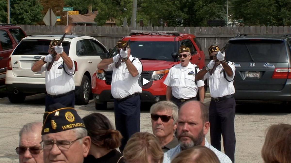 Veterans firing rifles