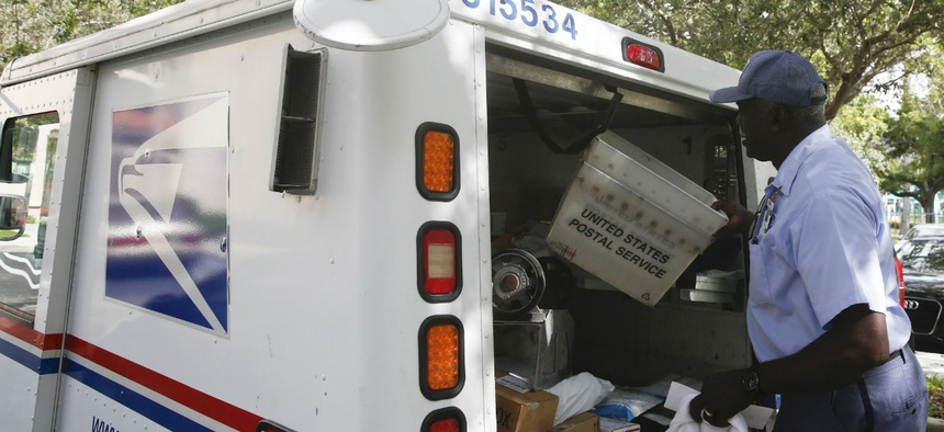 Postal Worker loading Postal Jeeo