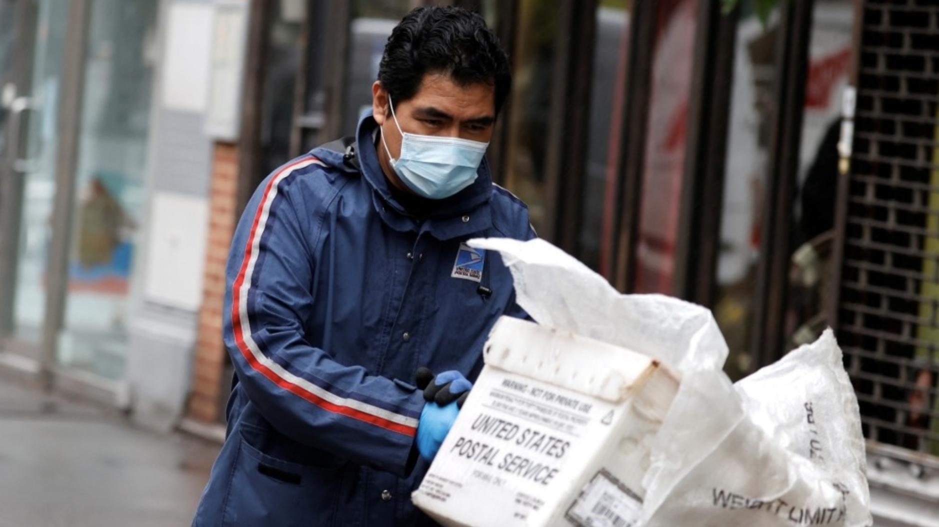 Postal worker wearing a mask